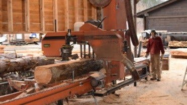 Harrop-Procter Community Co-op LT70 sawmill cutting
