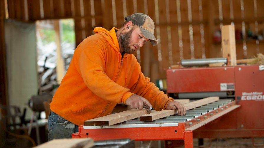 Luke using Wood-Mizer EG200 board edger