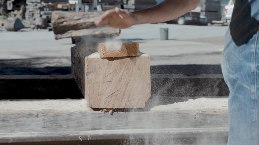 Stacked wood boards with sawdust